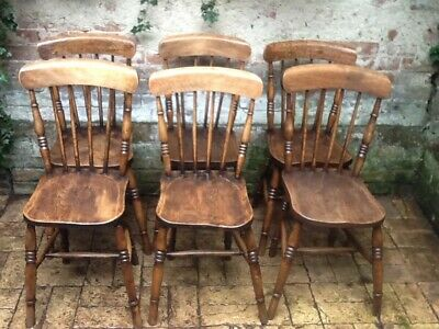 A set of six Antique stick back country Beech and Elm Dining Chairs.