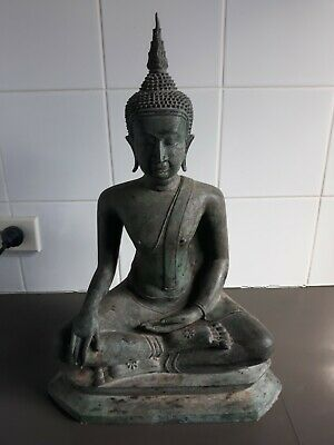 Old Sukothai bronze Buddha with flower pattern on hand and feet.