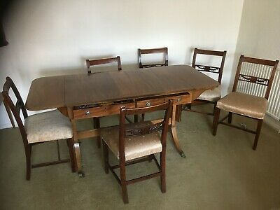 Antique woodern dinning table with extender flaps