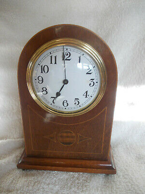 A VINTAGE WURTTEMBERG MANTEL CLOCK, working but sold as spares or repairs