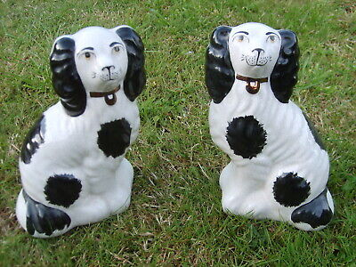 A Pair of Staffordshire King Charles Spaniel Mantle / Fireside Dog