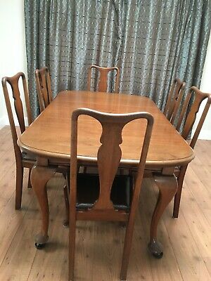 Antique Victorian mahogany extended table and 6 chairs with wind out leaf.