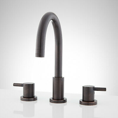 Rotunda Faucet with Lever Handles and Overflow in Dark Antique Bronze