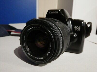 Canon EOS SLR 35mm Camera with Sigma 35-80mm 1:4-5.6 Zoom lens plus strap