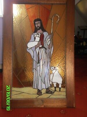 Stained glass image of Jesus Lamb of God with stand