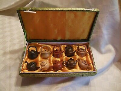Chinese collection of 10 miniture teapots in wooden case