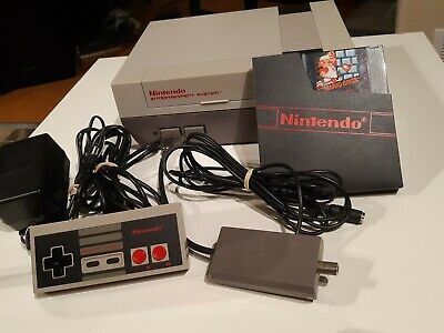 NES Nintendo Entertainment System Console, controller, hookups, and game.