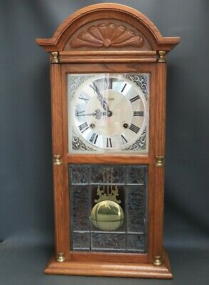 Vintage Highlands oak wooden striking wall clock with leaded glass panel