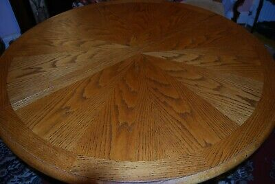 Solid wood oak extending dining table - round pedestal with lions feet