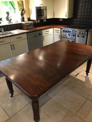 Antique Victorian Mahogany extending dining table, carved legs, castors. Sturdy,
