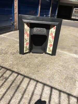 Victorian-style cast metal Fireplace with tiles, islington