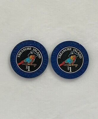 Two (2) Las Vegas Casino Chips $1 Treasure Island 1993