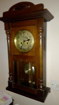 Vintage pendulum wall clock. In fine hardwood case. Missing bit so spares/repair