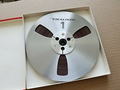"Realistic 7"" Metal Take Up Reel With Tape."