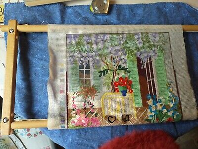 Tapestry working frame with incomplete work on