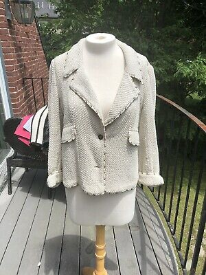 Authentic Ivory chanel jacket with gold buttons and gold and metal rings 42