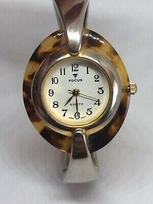 Working Ladies Gold and Faux Tortoise Shell Focus Bangle Watch  CK