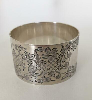 Top quality very ornate sterling silver napkin ring.   Clean and perfect