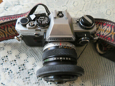 Olympus Om10 System Slr Camera Complete With Strap, Filter & Sun Glare Deflector