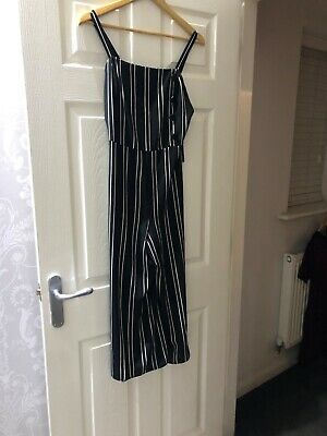 cullotte jumpsuit size 8 black and white striped brand new with tags..