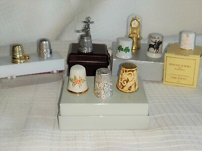 THIMBLES-LOT OF 9 Vintage to current production. Sterling, Porcelain, & Pewter