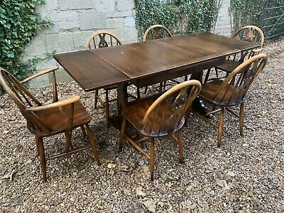 Ercol Extending Draw Leaf table And Six Spindle Back Chairs . Delivery Available