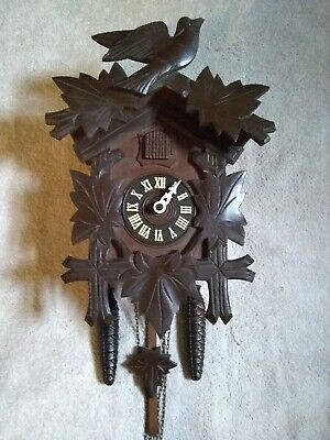 Black forest mechanical 30 hour  cuckoo clock in  excellent working condition