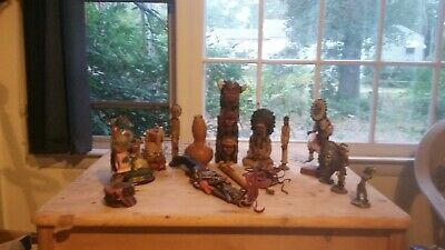 Indian figurines  Caribbean Indians metal and stuff dolls flute knife trinkets