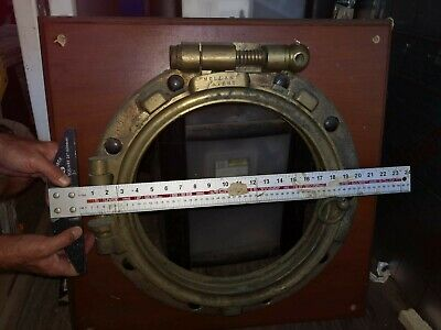 Antique brass portholes