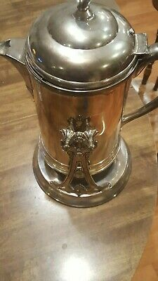 American Soda Fountain silverplate water pitcher:  80 yrs old with stand