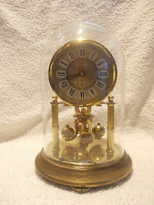 kundo anniversary clock with glass dome sold as spares or repairs