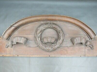 Antique carved oak wooden furniture or door pediment of wreath and ribbons