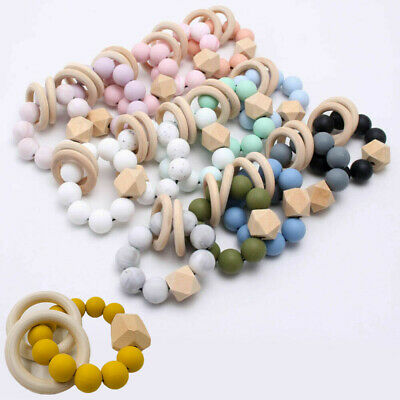 Chewable Wooden Ring Rattles Teether Baby Silicone Teething Bracelet Beads Toys
