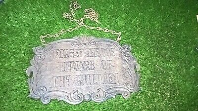cast iron plaque on chains