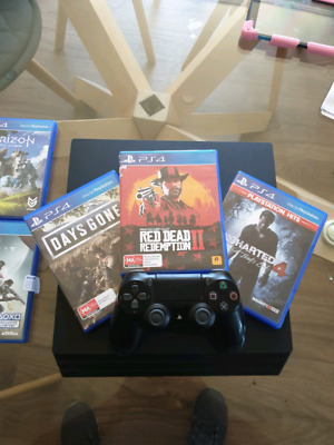 PS4 Pro 8 games dual charger great condition RDR2, Days Gone, Uncharted 4, etc