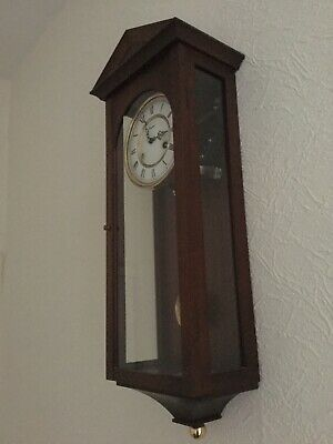wall clocks with pendulum