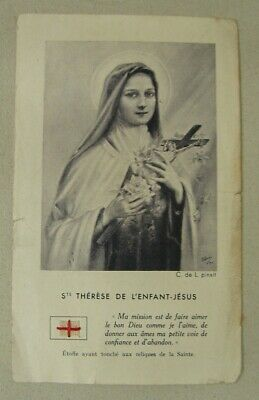 Y10. Godly image of Therese of the Child Jesus with relic and prayer on the back