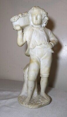 antique carved alabaster marble stone figural boy with fruit sculpture statue