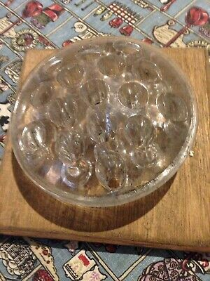 Vintage glass flower frog 16 holes on wooden base.