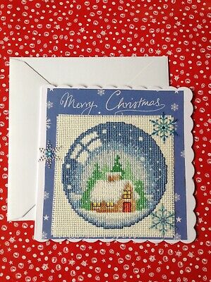 Completed cross stitch christmas card, snowglobe cabin