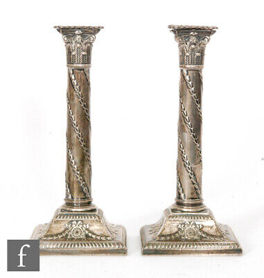 1913 pair of hallmarked silver candlesticks, square bases cylindrical columns