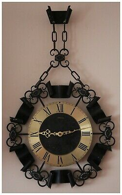 Vintage EURASTYLE Handle Wall Quartz Clock. Made in West Germany.