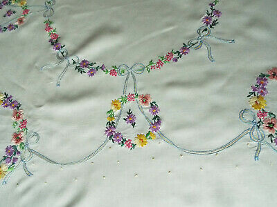Fabulous old/vintage tablecloth hand embroidered with several rings of flowers