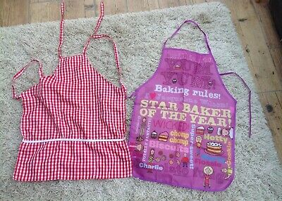 Two Children's Aprons Pre Owned
