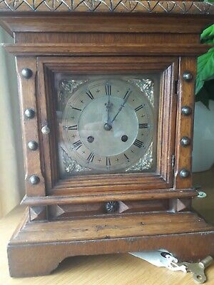Vintage bracket clock with pendulum and key....suit clock repairer