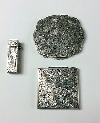 Three antique 800 silver Art Nouveau chased compacts