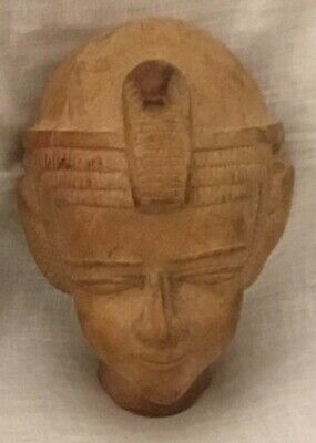 Ancient Egyptian pottery style head, with a serpent crown.