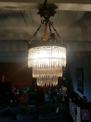 Antique French lead crystal chandelier with brass putti and elegant crystal