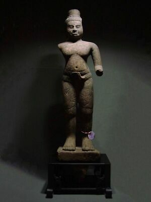 A STANDING FIGURE OF A MALE DEITY 'BANTEAY SREI' STYLE. STONE. CAMBODIA 10th C.