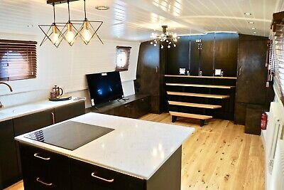 HAUS - a Stylish and Contemporary Live-aboard Widebeam Boat